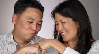 Member Story: John & Lori Katahira fist bumping