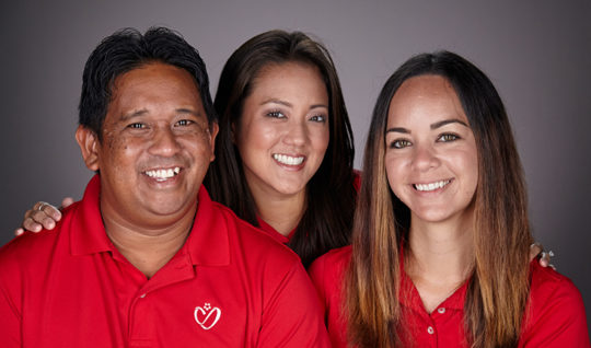 Three happy employees.
