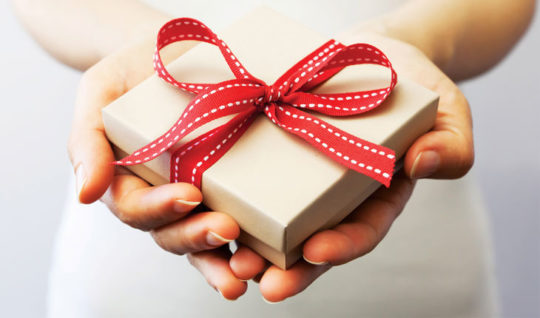 personal loan promotion with a woman's hands holding a gift