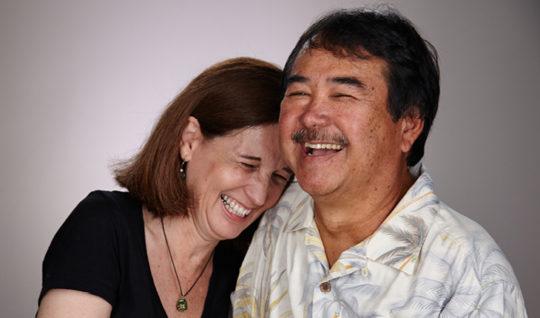 Happy retired couple smiling.
