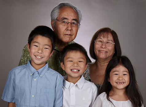 Grandparents with their three grandchildren.