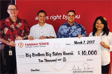 Check presentation to the Big Brothers Big Sisters with a donation of $10,000.