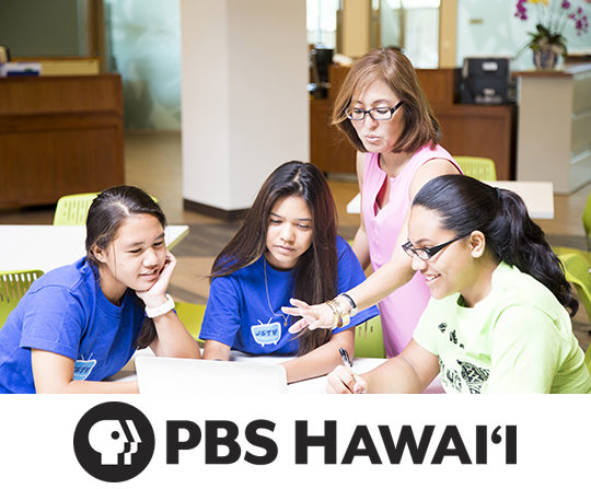 Teacher and students around a table with PBS logo