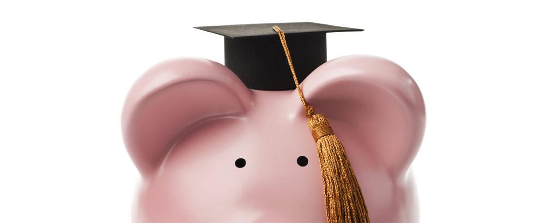 A piggy bank wearing a graduation hat