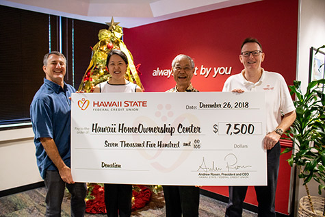 Hawaii State FCU Executives pose for a picture with leaders from the Hawaii HomeOwnership Center with a big check in the amount of $7,500 in December 2018,