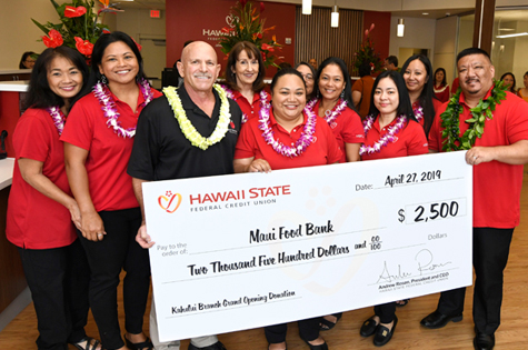 Kahului Branch Employees pose for a picture with a leader from the Maui Foodbank with a big check in the amount of $2,500. The check was presented at the grand re-opening of the Hawaii State FCU Kahului Branch.