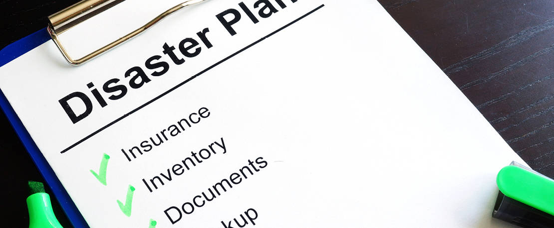 Photo of a disaster preparedness checklist including Insurance, Inventory, Documents, Backup