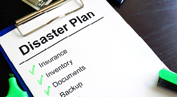 Photo of a disaster plan checklist including Insurance, Inventory, Documents and Backup.