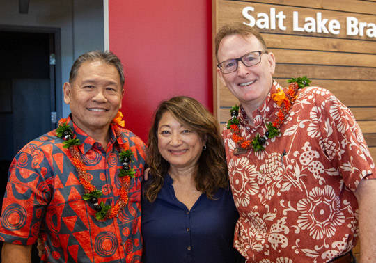 Photo of 3 HSFCU employees smiling and enjoying the Salt Lake Branch opening.