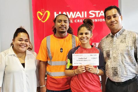 2019 Hawaii State FCU Q3 Refer A Friend Winner, Kamalani Ganal, poses with friends with a Hawaii State FCU employee.