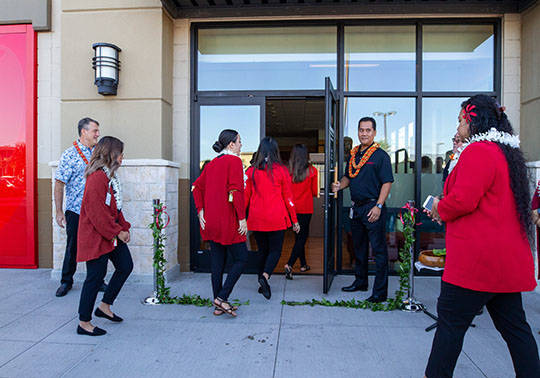 Photo of HSFCU employees entering the new Ewa Beach Branch after the blessing.