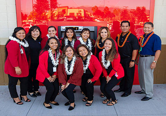 A photo of the Ewa Beach Branch employees outside of the new Ewa Beach Branch infront of the ATM machine area.