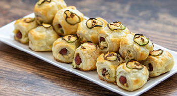 A photo of the Bites on a Budget Jalapeno Popper Pigs in a Blanket appetizer.