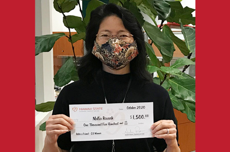 Photo of our 2020 Q3 Refer a Friend winner, Malia Rausch holding her $1,500 check.
