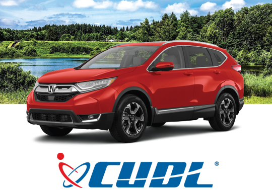 Red SUV in front of lake with CUDL logo