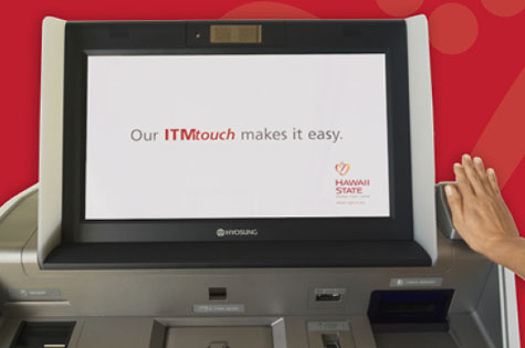 Photo of the ITM and a hand over the palm scanner