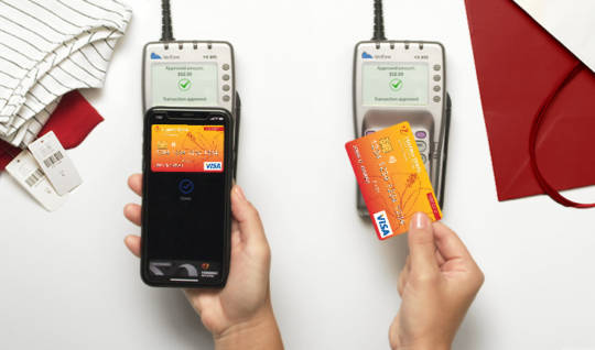HSFCU Visa<sup>®</sup> credit card loaded in a digital wallet and a contactless credit card used for payment