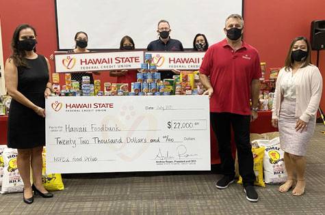 Hawaii State FCU Exectuives presenting a check for $22,000 to the Hawaii Foodbank.