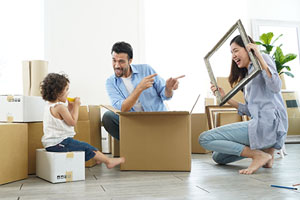 Family unpacking boxes in their new home